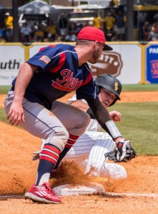 Dylan Burdeax slides into third base  with a safe for the Golden Eagles
