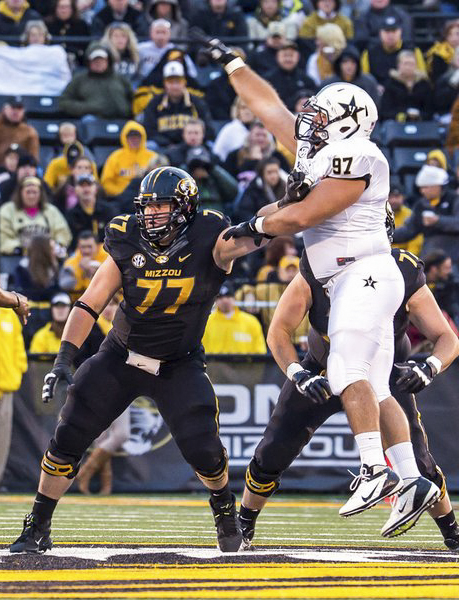 Missouri Tigers senior offensive lineman Evan Boehm (77) blocks a defender during a game against the Vanderbilt Commodores at Faurot Field in 2012. MANEATER FILE PHOTO