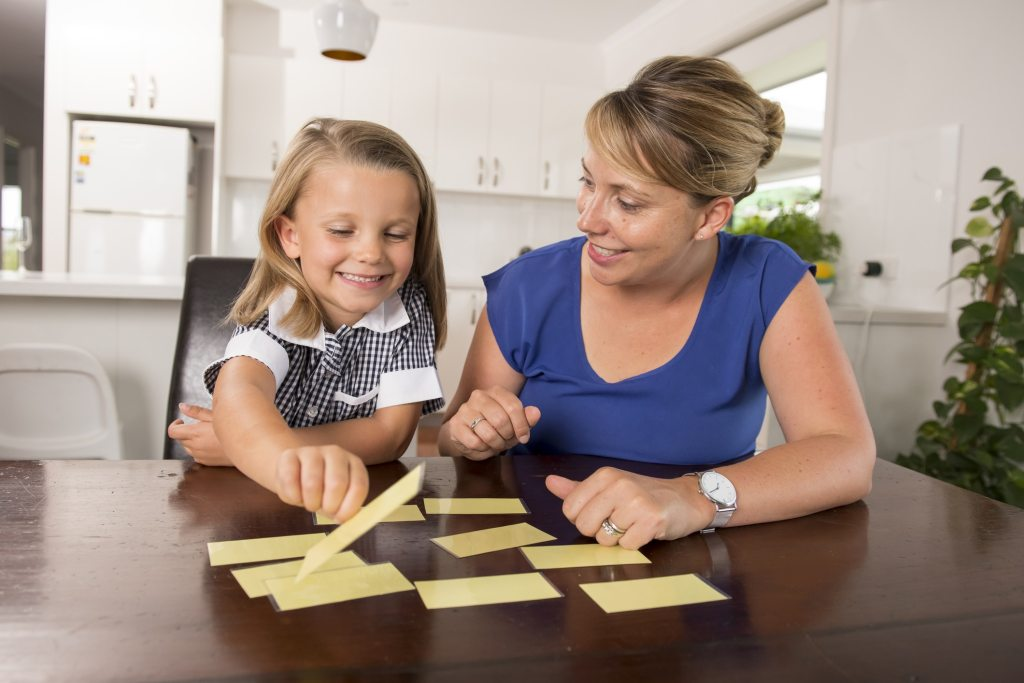 mother and child sorting cards
