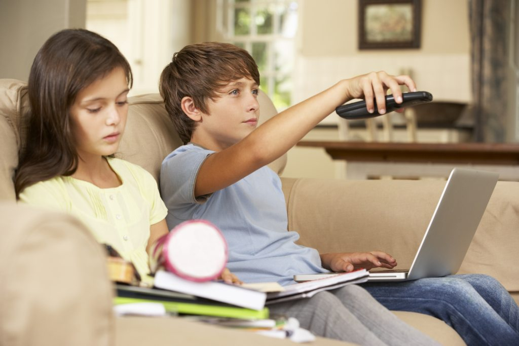 Two Children Distracted By Television