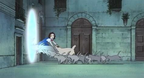 La horde de chats passe par des tunnels magiques pour rejoindre le Royaume des Chats.