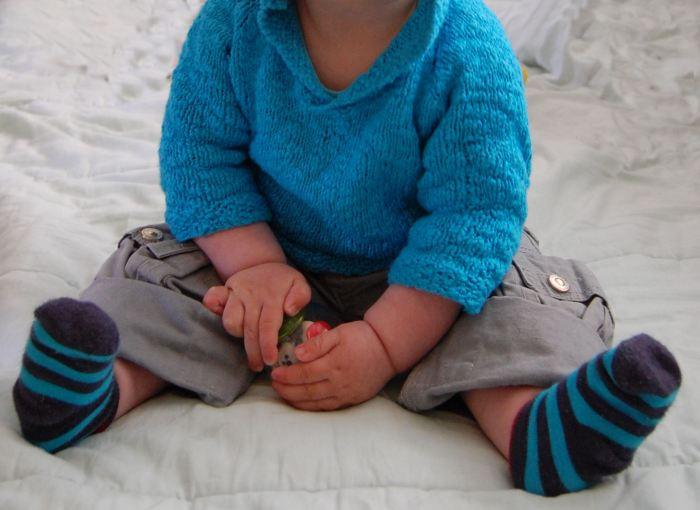 baby met trui door studio paars