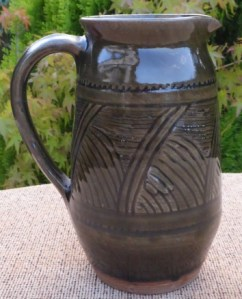 Katharine Pleydell-Bouverie green glazed jug with a firing imperfection. The height is 17.25 cm (6.8 inches). Price: £225