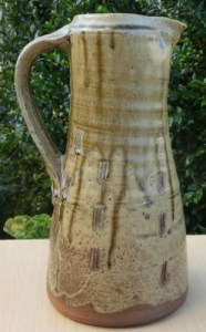 Jim Malone tall ash glazed jug with personal seal and Ainstable seal. Height: 30.5 cm (12.0 inches). Price £185