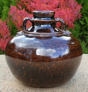 UM8 - Ursula Mommens (1908 - 2010): Handled stoneware jar with personal seal. The height is 14.0 cm (5.5 inches) and the maximum diameter is 15.0 cm (5.9 inches). £245