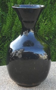 TC06 - Poh Chap Yeap (1927 - 2008) thrown and altered stoneware vase with tenmoku glaze. Signed Yeap on the base. The maximum height is 22.6 cm (8.9 inches) £200