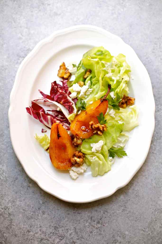 Pan Roasted Pear Salad on a white platter with gray background