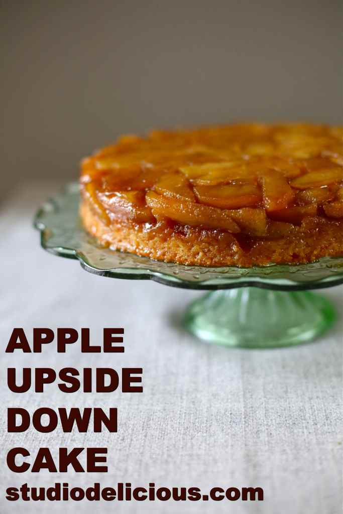 Apple Upside Down Cake with text of same on a green glass stand plate