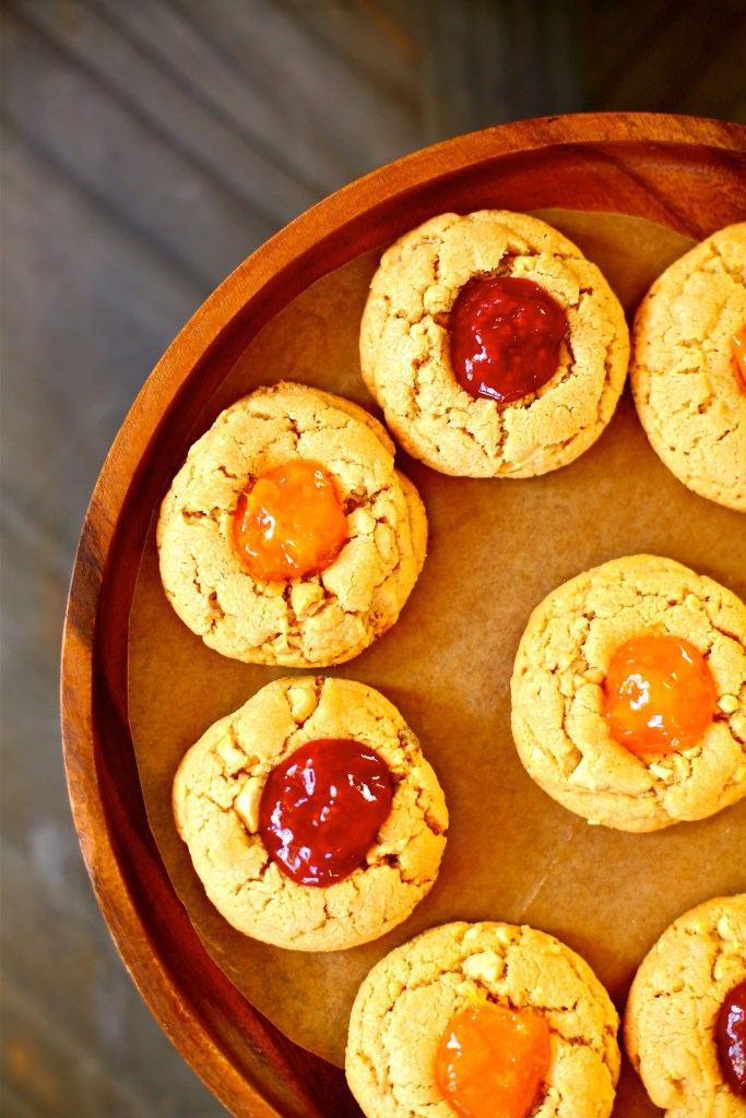 Peanut Butter and Jam Cookies on a wooden platter