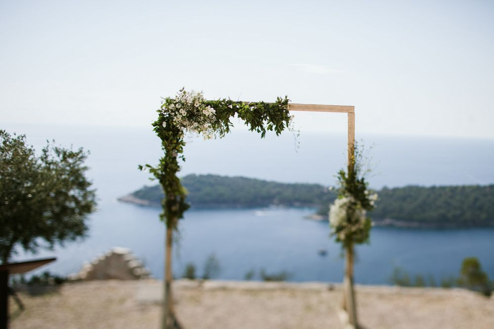 Beautifly decorated arch at Park Orsula - Eon & Warrick's Gay destination wedding in Dubrovnik, Croatia
