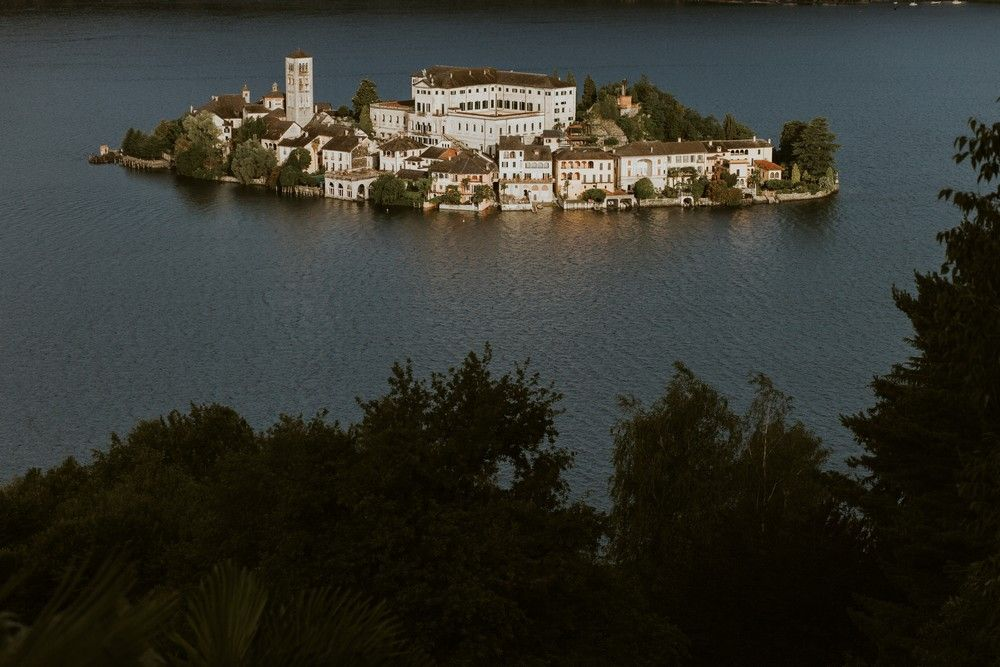 The view of San Giulio Island at Lake Orta. Photo by DTstudio Italy wedding photographer