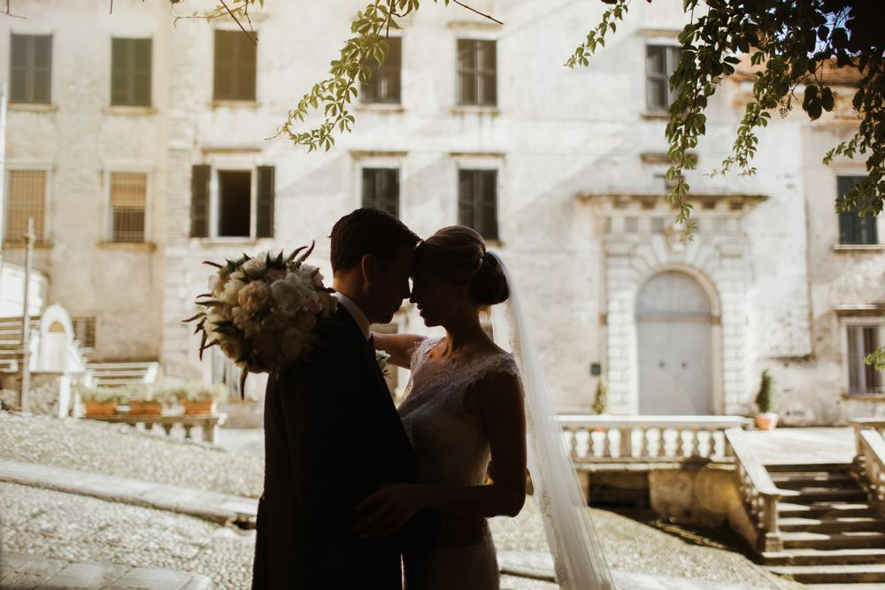 Italian lakes wedding - a newlyweds posing in front of the photo camera of talented Lake Como wedding photographer.
