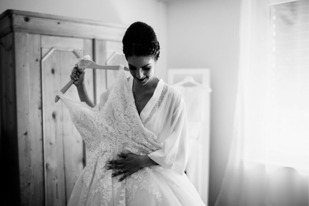 Bride with her Wedding Dress during preparations for Wedding in Chur, Switzerland