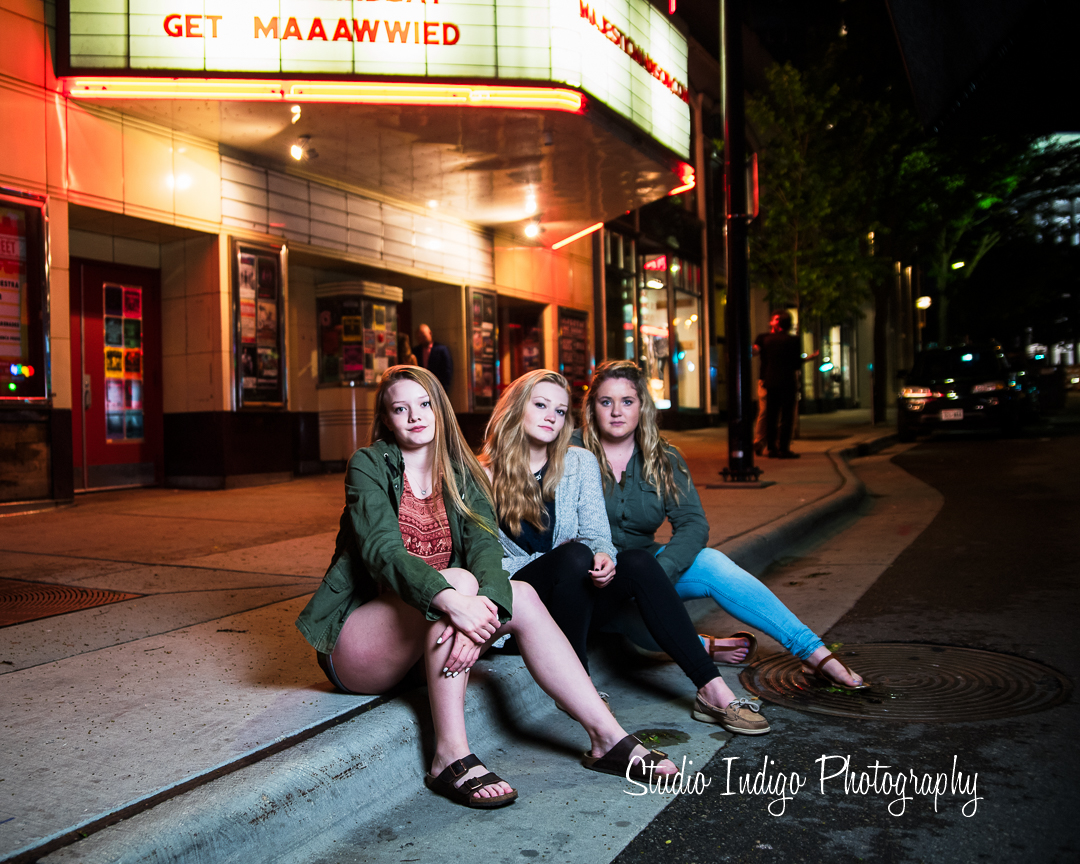 Dramatic lighting for this friend/sister senior portrait outside the majestic theater in downtown madison.  Serena and Jenna are sisters and Allie is their BFF.  It was a great idea to shoot all 3 togehter.  What a great time during this friend/sister high school senior portrait session.
