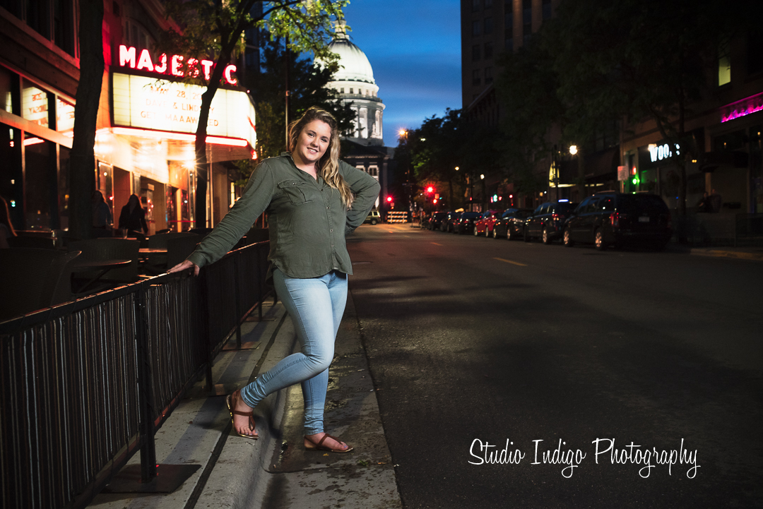 Posing outside the capital and majestic theater in downtown madison for a stylish senior portrait.