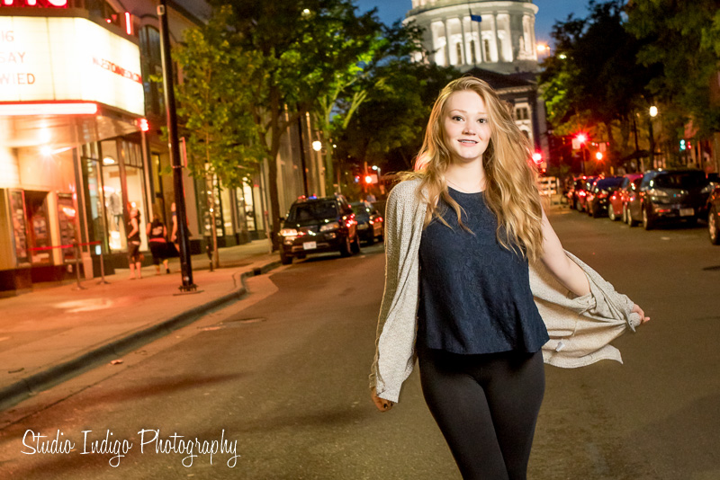 Photographing this senior portrait walking down the street with the senior model swinging her arms.  And she doesn't have to do big movements, even little movements get the job done.  This is one of my favorite shots with the photo journalistic feeling and dramatic lighting.