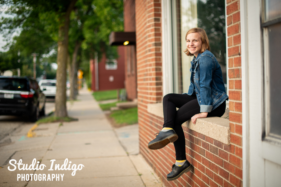 Senior yearbook portrait of girl sitting on window ledge in schenks corners madison