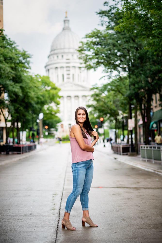 High school senior portrait of a girl in front of the Wisconsin Capital on State St