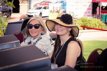 Judges Staci Mehl and Vickie Lavanty evaluate the contestants in the Hollywood Fashion Contest during the 2015 Bing Crosby Opening Day at Del Mar.