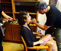 MUA James Overstreet prepping the model before the shoot, making sure her make-up is perfect for the next fall issue for Ranch & Coast!