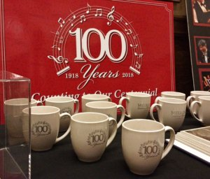 Centennial logo and application on mugs