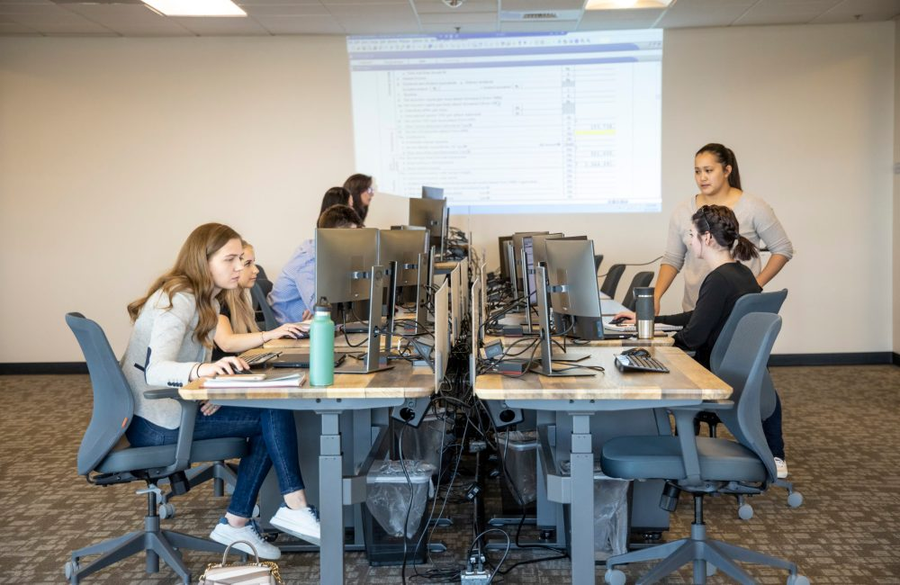 Students on the computer in The Studio Coworking Creekside in Roseville, CA.