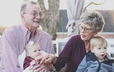 Elderly couple with grandkids