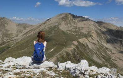 Woman enjoying view while rock climbing