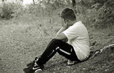 Young boy, sad