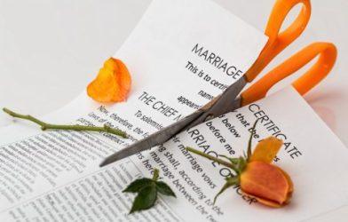 Divorce; marriage certificate cut by scissors