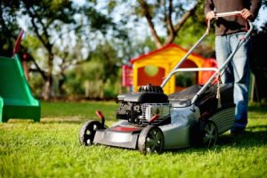 Person using lawn mower