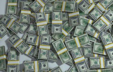 Piles of cash in hundred dollar bills