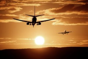 Airplanes flying in sunset