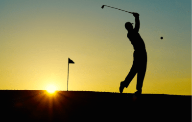 Silhouette of person playing golf