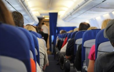 Passengers inside an airplane cabin