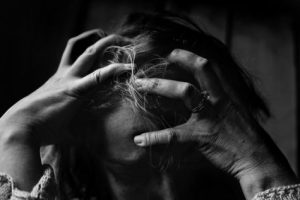Woman feeling stressed, frustrated