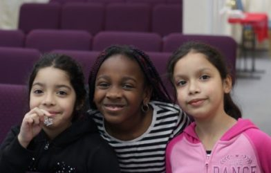 Young girls posing in school