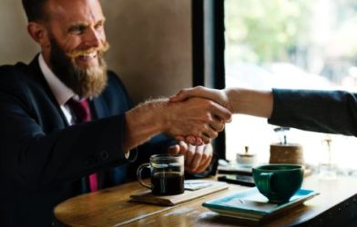 Man meeting with someone, shaking hands