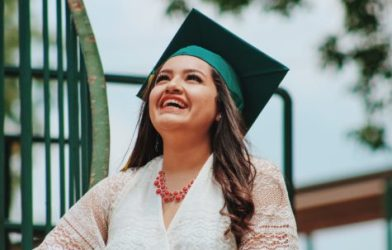 Latino woman celebrates graduating