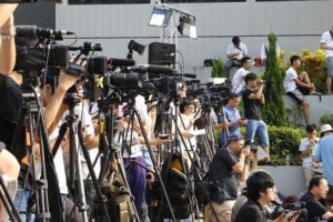 Television news reporters and cameras