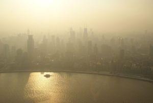 Smog and air pollution causes a haze over a city