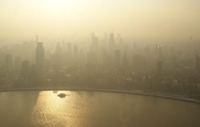 Smog and air pollution causes a haze over a city