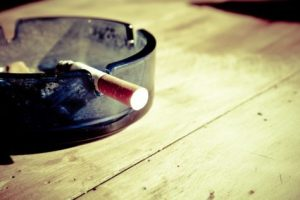 Cigarette in ashtray