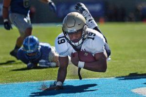 Football player scoring a touchdown