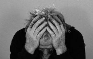 Man battling headache, stress