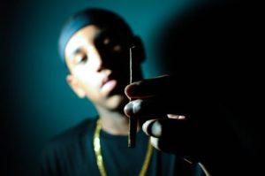 Man holding marijuana joint