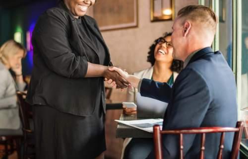 Woman, man shaking hands