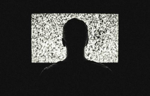 Person in front of television