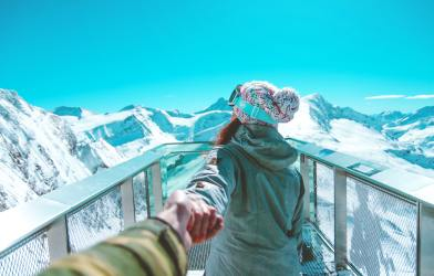 Couple on snowy mountain