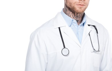 Doctor with neck tattoos